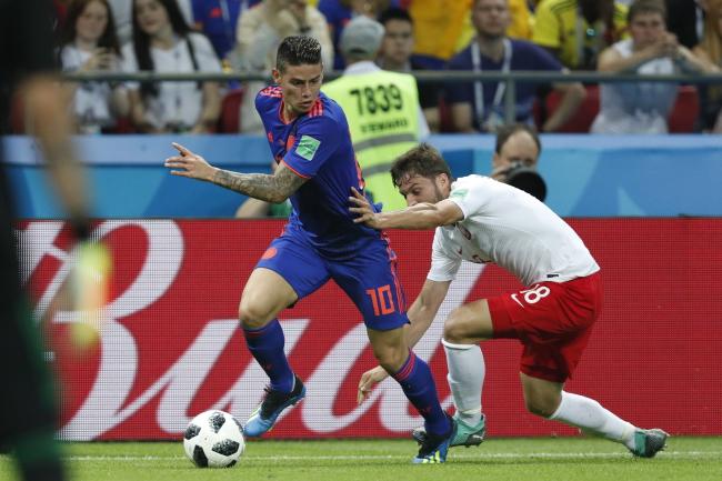 Фото с матча Польша-Колумбия.