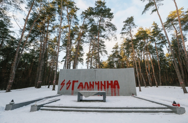 The words 'SS Galizien' are painted on a monument wall with names of murdered people at the mass grave of Polish executed in 1937-1940 by the Red Army in Bykownia near Kiev, Ukraine, 25 January 2017. Photo: EPA/SERGEY DOLZHENKO