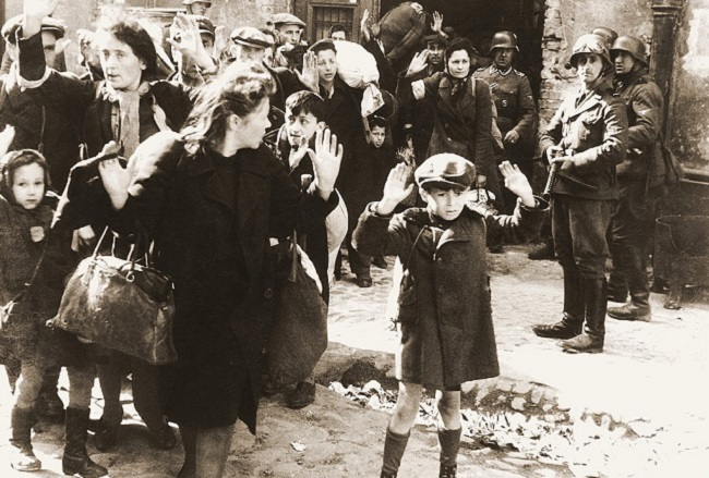 Warsaw Ghetto Uprising; photo from Jürgen Stroop's report to Heinrich Himmler from May 1943; National Archives and Records Administration [Public domain], via Wikimedia Commons