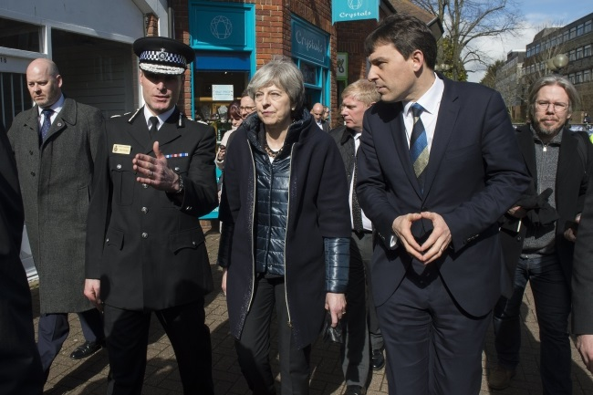 British Prime Minister Theresa May (centre) during her visit on Thursday to Salisbury, the town in southern England where ex-spy Sergei Skripal and his daughter are believed to have been attacked with a nerve agent on March 4. Photo: EPA/STRINGER