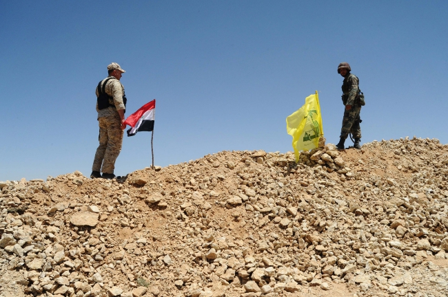 A handout picture made available by the official Syrian Arab News Agency (SANA) apparently  showing Syrian army soldiers and Hezbollah members in their positions in the Flita height in the Qalamoun mountains at the Syrian-Lebanese border, on 06 June 2015. EPA