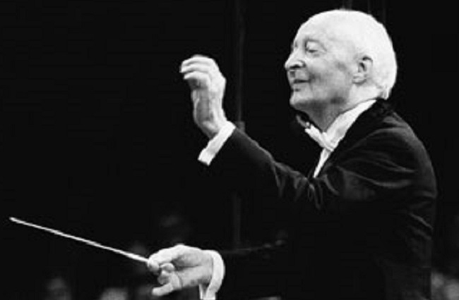 Photograph of Witold Lutosławski conducting, taken by Juliusz Mułtarzyński (1991); Wikimedia Commons, Public domain