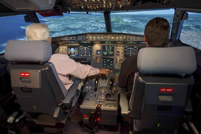 An undated handout picture isued by Airbus company of an interior view of a Airbus A320 cockpit simulator. One of the two pilots was locked out of the cockpit on Germanwings flight 4U9525 when it crashed in the French Alps on 24 March 2015. Photo: EPA/JASON CALSTON / AIRBUS HANDOUT