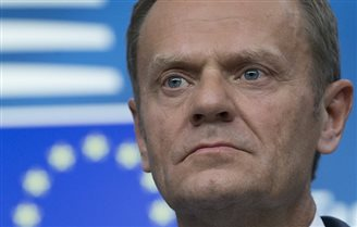 EU's Tusk seeks legal action after being portrayed in SS uniform