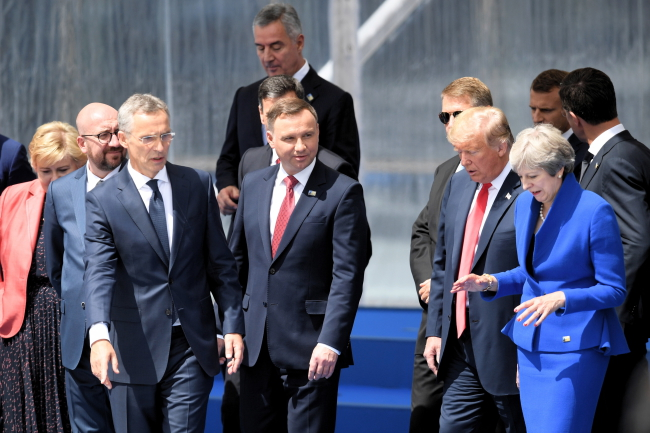 Polish President Andrzej Duda (centre) and other NATO leaders at the summit. Photo: PAP/Radek Pietruszka.