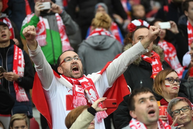 Poland fans cheer on their team during the game against Montenegro at the National Stadium in Warsaw on Sunday. Photo: PAP/Bartłomiej Zborowski