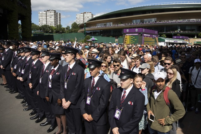 Spectators arrive for first-round action during the Wimbledon Championships at the All England Lawn Tennis Club in London on Monday.