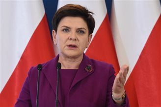 Poland will not introduce 'incompatible' legal changes: PM