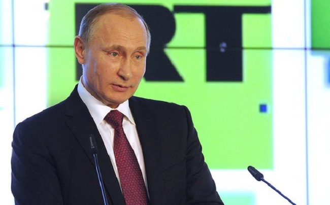 Russian head of state Vladimir Putin being interviewed by RT. Photo: Kremlin.ru