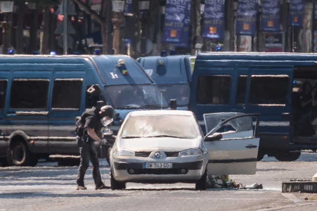 One dead after vehicle rams police van in Paris