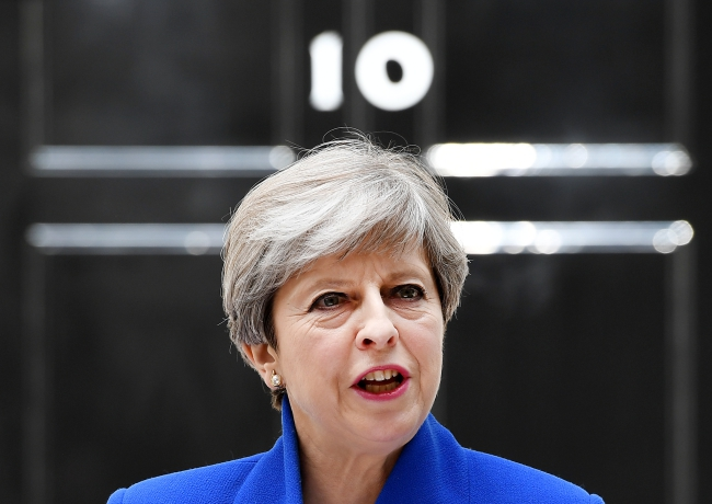 Theresa May apologises to own MPs for election 'mess'
