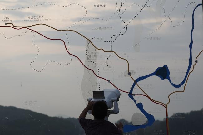 A child looks through binoculars towards North Korea from South Korea, near the demilitarised zone. Photo: EPA/JEON HEON-KYUN.