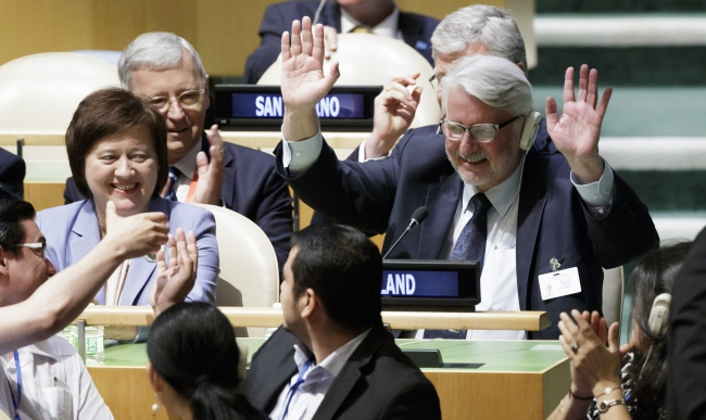 Witold Waszczykowski (R) and his delegation celebrate after Poland was elected to fill a non-permanent role of the United Nations Security Council. Photo: EPA/JUSTIN LANE