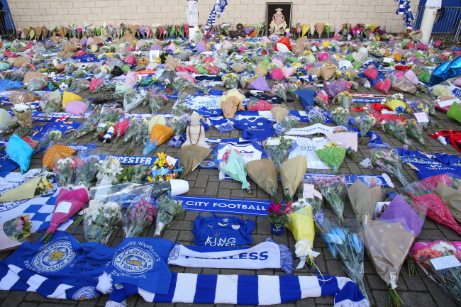 Flowers outside the King Power stadium in Leicester, Britain after the tragic chopper crash. Photo: EPA/TIM KEETON