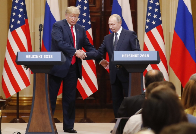Donald Trump and Vladimir Putin. Photo: EPA/ANATOLY MALTSEV