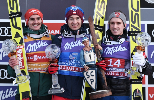 Winner Kamil Stoch of Poland (C), second placed Richard Freitag of Germany (L) and third placed Anders Fannemel of Norway (R) celebrate on the podium during the second stage of the 66th Four Hills Tournament in Garmisch Partenkirchen, Germany, 01 January 2018. Photo: EPA/Christian Bruna