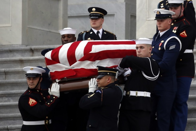 The flag-draped casket of former US President George H.W. Bush is carried in Washington on Wednesday. Photo: EPA/ALEX BRANDON
