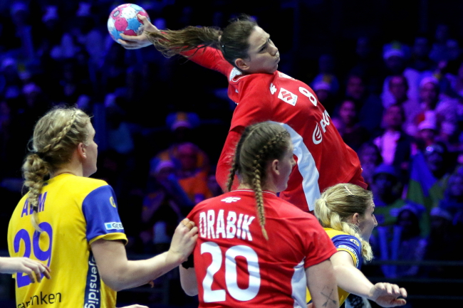 Poland's Monika Kobylińska in action against Sweden. Photo: EPA/EDDY LEMAISTRE