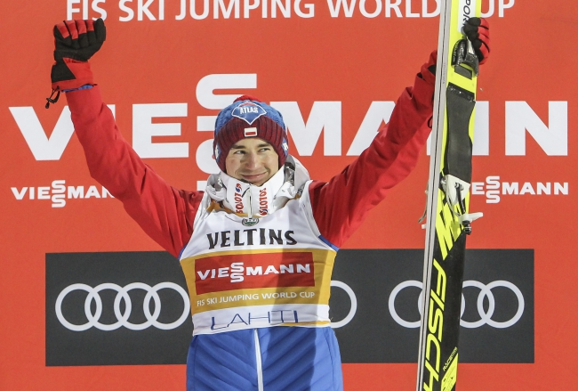 Kamil Stoch celebrates on the podium. Photo: EPA/PEKKA SIPOLA