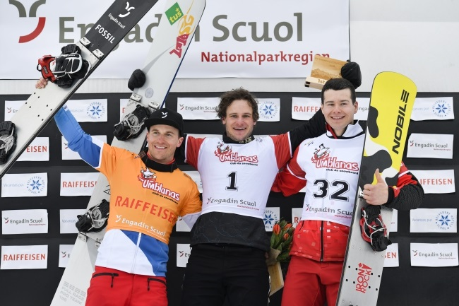 Oskar Kwiatkowski (right) celebrates on the podium together with third-placed Nevin Galmarini of Switzerland (left) and winner Tim Mastnak of Slovenia (centre), after the final of the FIS Snowboard World Cup Parallel Giant Slalom race in Scuol, Switzerland, on Saturday. Photo: EPA/GIAN EHRENZELLER