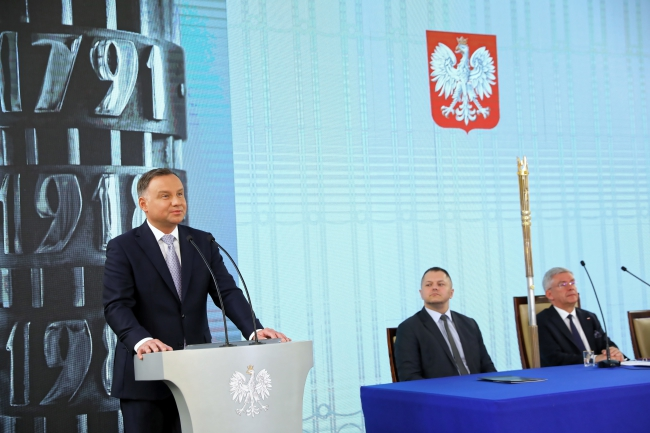 President Andrzej Duda (left) in the Polish parliament on Tuesday