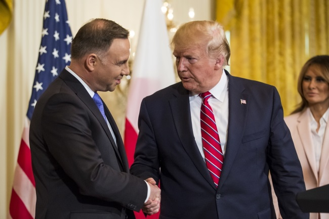 Polish President Andrzej Duda shakes hands with US President Donald Trump at the White House in Washington on Wednesday.