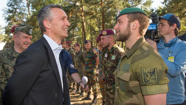 NATO Secretary-General Jens Stoltenberg (left) is pictured visiting troops in Poland. Photo: NATO