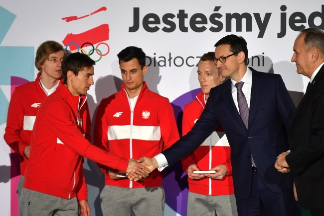 Polish ski jumpers Dawid Kubacki, Kamil Stoch (foreground), Maciej Kot and Stefan Hula meeting PM Mateusz Morawiecki on Monday.