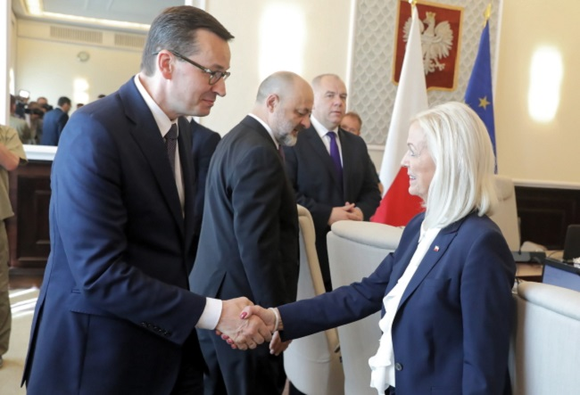 Poland's Prime Minister Mateusz Morawiecki (left) and his new Family, Labour and Social Policy Minister Bożena Borys-Szopa (right) before a Cabinet meeting in Warsaw on Tuesday. Photo: PAP/Tomasz Gzell