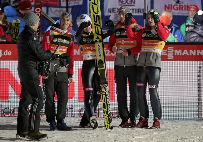 Team Poland Piotr Żyła, Kamil Stoch, Dawid Kubacki and Maciej Kot celebrates winning the long hill team event at the Ski Jumping World Cup in Willingen, Germany, 28 January 2017. Photo: EPA/HASAN BRATIC