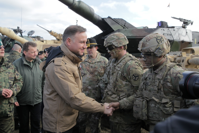 Andrzej Duda (centre) meets troops at a training ground in Orzysz, north-east Poland, on Wednesday. Photo: PAP/Tomasz Waszczuk