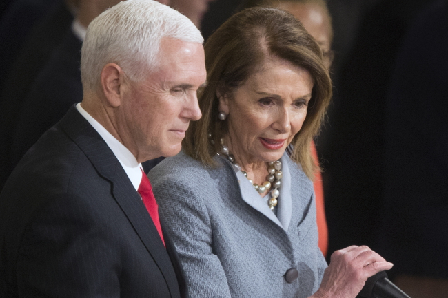 US Vice President Mike Pence (left), pictured with US Speaker of the House Nancy Pelosi.
