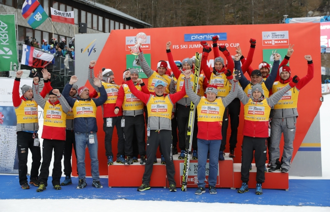Polish team celebrates their overall Nations Cup victory during the Ski Jumping World Cup Final in Planica, Slovenia. Photo: EPA/ANTONIO BAT