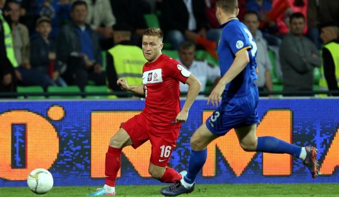 Zdobywca bramki dla Polski - Jakub Błaszczykowski (w czerwonym stroju)