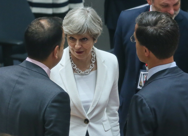 British Prime Minister Theresa May (C) in Brussels on Friday. Photo: EPA/STEPHANIE LECOCQ