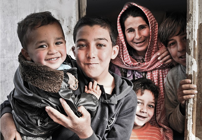 "Part of a poster for Caritas's ""Family for Family"" programme of aid to middle eastern asylum seekers. Photo: Caritas"