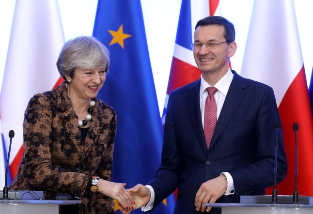 Theresa May and Mateusz Morawiecki at a press conference in Warsaw on Thursday. Photo: PAP/Rafał Guz