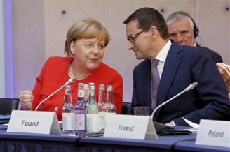 Polish PM in Berlin urges responsible climate policy