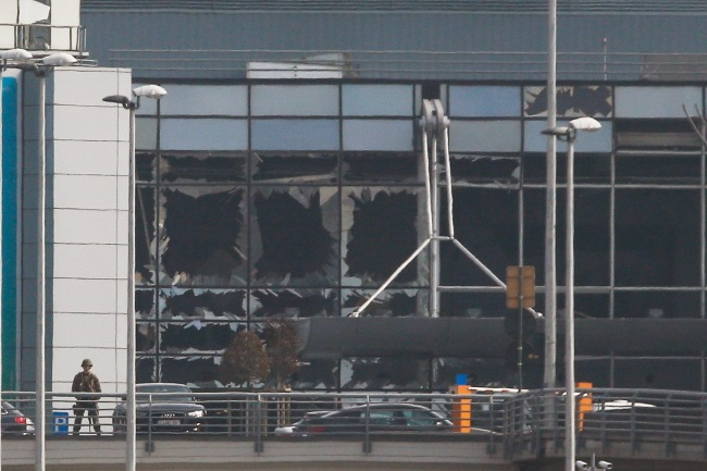Destroyed windows at the terminal building after explosions at Brussels airport. Photo: EPA/LAURENT DUBRULE