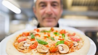 Drunk pizza delivery man unwittingly turns up at police station