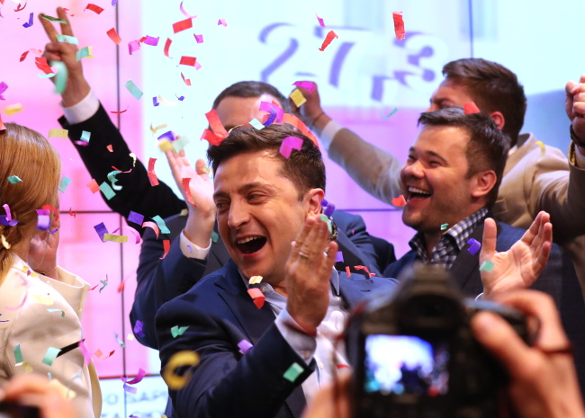 Volodymyr Zelensky (centre) after the announcement of exit-poll results during the Ukrainian presidential elections in Kiev on Sunday.