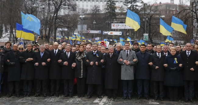 Ukrainian president Petro Poroshenko (C) with his counterparts and top officials from EU attend the 'March of Dignity' in Kiev, Ukraine, 22.02.2015. European countries presidents and top officials took part in events to mark the first anniversary of the escalated violence on the Maidan, in memory of people, who were killed on the Maidan and eastern