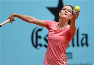 Polish tennis star wins in second round in Dubai