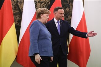 Germany's Merkel visits Warsaw