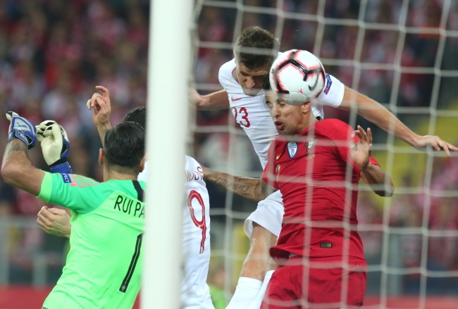 Krzysztof Piątek (right) powers home a header for Poland against Portugal at the Silesian Stadium in Chorzów on Thursday. Photo: PAP/Andrzej Grygiel