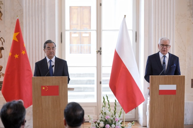 Poland's Jacek Czaputowicz (right) and China's Wang Yi (left) meet in Warsaw on Monday.