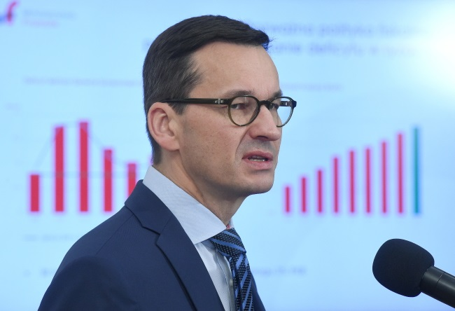 Deputy PM and Finance and Development Minister Mateusz Morawiecki briefs reporters on Poland's budget at a news conference in Warsaw on Tuesday. Photo: PAP/Radek Pietruszka