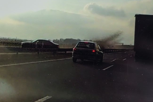 The moment President Andrzej Duda's car (left) veered off the road, as captured by a car camera in a vehicle heading in the opposite direction. Image distributed by PAP
