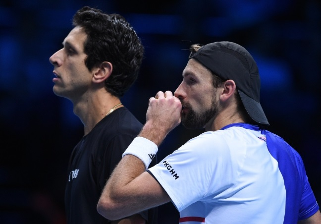 Łukasz Kubot of Poland (right) and Marcelo Melo of Brazil. Photo: EPA/FACUNDO ARRIZABALAGA.