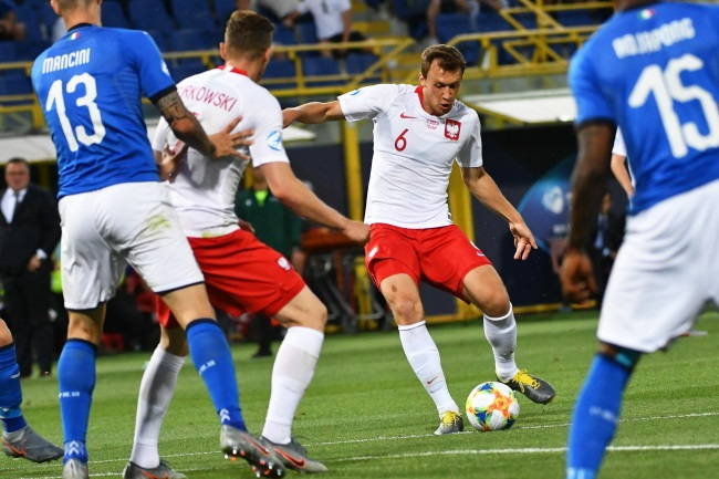 Poland's Krystian Bielik (second from right) in action against Italy in Bologna on Wednesday.